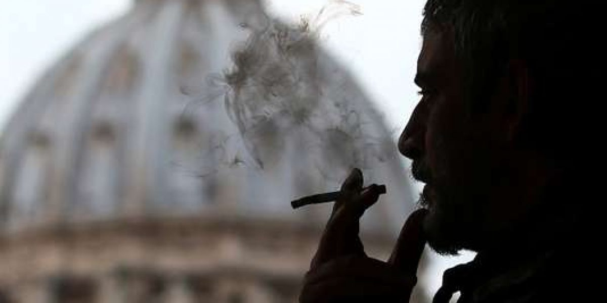 A man smokes a cigarette in front of St. Peter Square, in Rome, Italy November 9, 2017. REUTERS/Alessandro Bianchi